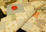 Pink and blue high-loft patchwork baby quilt