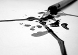 A broken fountain pen with spilled ink