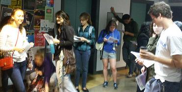 workshop participants wait in hallway for orientation